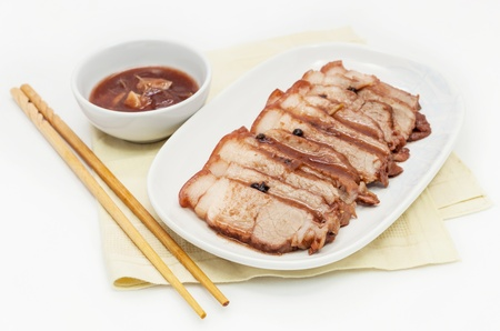 Chinese roasted red pork with  gravy sauce. photo