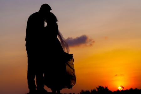 Silhouette couple on the beach  photo