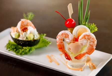 Shrimp cocktail in a glass with cream salad.