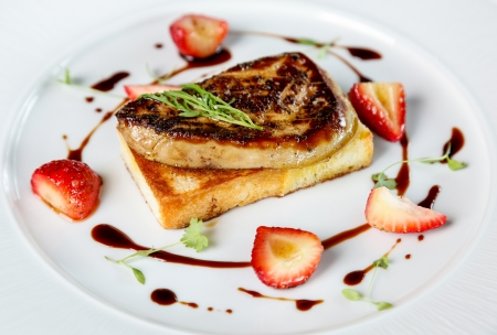 foie gras: Fried foie gras with strawberry and sauce .