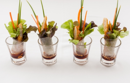 The tasty appetizers in glass  photo