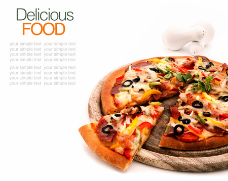 Delicious homemade pizza with ham and vegetables  Standard-Bild