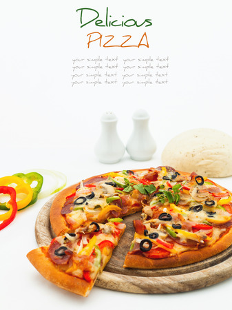 Delicious homemade pizza with ham and vegetables  photo