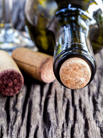 des vins: Bottle of wine and corks on wooden table. - Macro shot with selected focus. Stock Photo