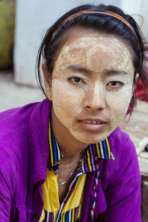 mach: BAGO  MYANMAR - Mach 4  2015, Girl use tanaka for skin care the traditional of Myanmar - An unidentified girl at Buddihist temple on Mach 4, 2015 in Bago, Myanmar , Use for editorial only. Editorial