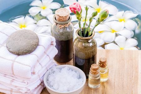 rejuvenate: Spa and wellness treatment setup on wooden panel. Stock Photo