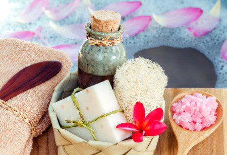 revitalize: Spa and wellness treatment setup on wooden panel. Stock Photo