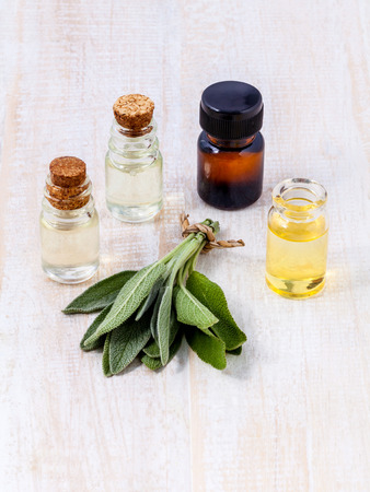 Natural Spa Ingredients  sage essential oil for aromatherapy. photo