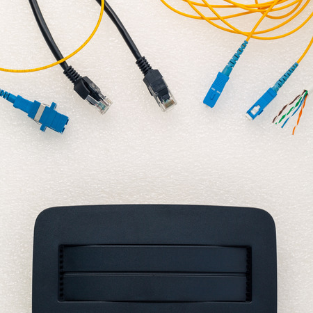 Above view of telecommunication connector with black router.