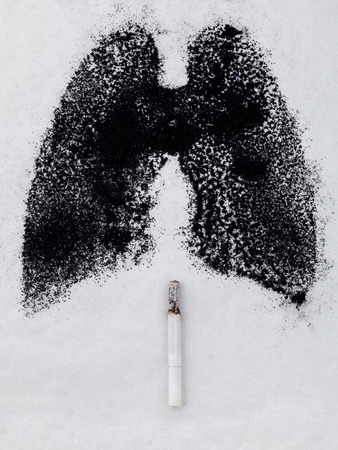 tar paper: Shape of lungs with charcoal powder and cigarette on white background Stock Photo