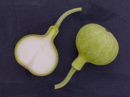 flowered: Halved bottle gourd,calabash gourd ,flowered gourd on wooden