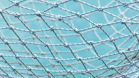 yacht club: Yacht safety nets of sailing yacht and ocean background.