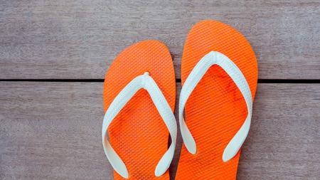 flops: Flip flops on sailing yacht floor for summer background .
