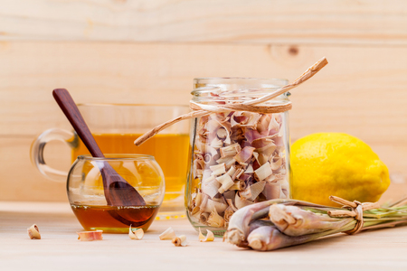 thai spa: Cup of herbal tea with dried lemon grass ,honey and lemon on wooden background.