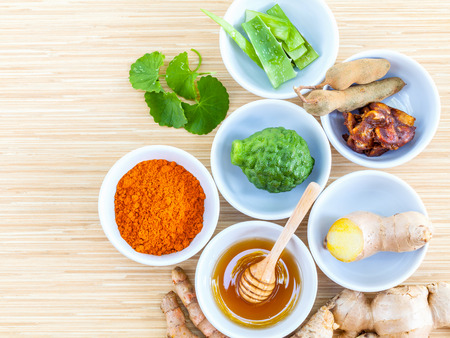 Homemade natural facial toner that for softens, smoothes,cleanses the skin in bowls with tamarind,honey,turmeric,aloe vera,kaffir lime,Gotu kola and ginger.