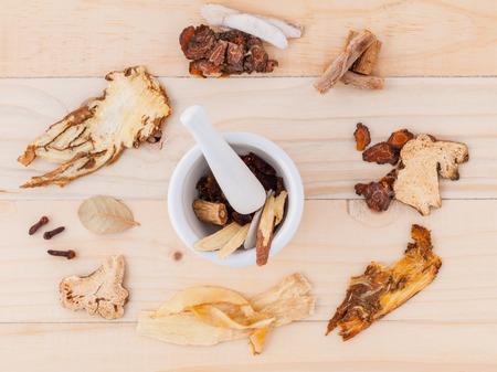 herbal background: Alternative Medicinal , Chinese herbal medicine  for healthy recipe with dry herbs  and mortar on wooden background.