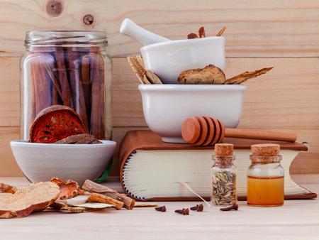Alternative Medicinal Chinese herbal medicine  for healthy recipe with dry herbs  and mortar on wooden background.