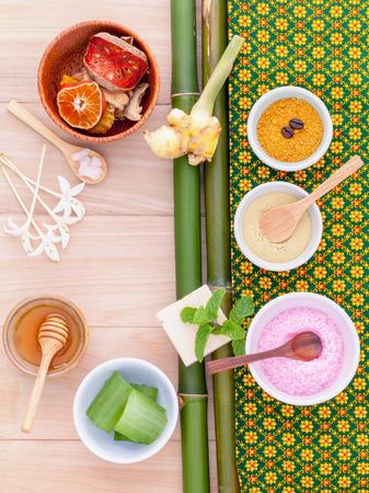 Natural Spa Ingredients sea salt , tanaka , aloe vera and honey  for alternative skin care Thai Spa theme with bamboo background.