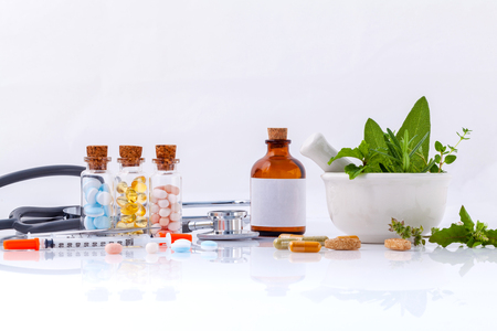 Herbal medicine VS Chemical medicine the alternative healthy care with stethoscope isolate on white background. Фото со стока - 46700708