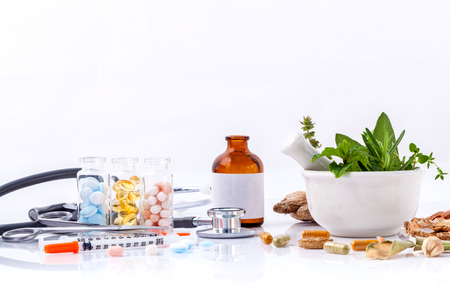Herbal medicine VS Chemical medicine the alternative healthy care with stethoscope isolate on white background.