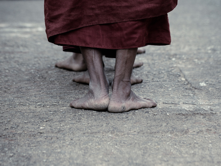 ascetic: Dramatic picture of ascetic Buddhist monk walking pray at the way to Kyaikhtiyo.