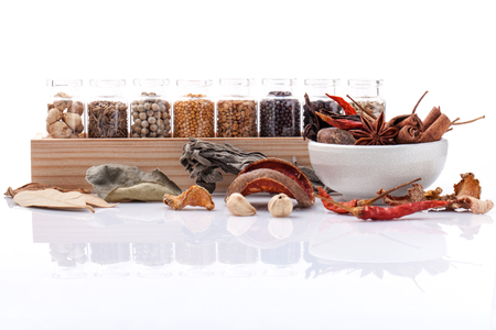 mustard leaf: Assorted of spice bottles condiment black pepper ,white pepper, black mustard,white mustard,fenugreek,cumin ,bay leaf ,cinnamon and fennel seeds with mortar isolated on white background.