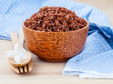 red kitchen: Steamed whole grain traditional thai rice best rice for healthy and clean food on wooden background Stock Photo
