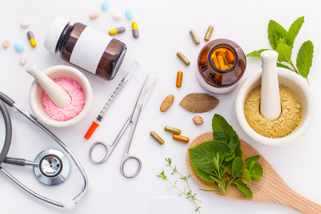pharmacy pills: Herbal medicine VS Chemical medicine the alternative healthy care on white background.