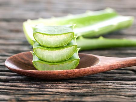burn: Aloe Vera slice natural spas ingredients for skin care on wooden background.