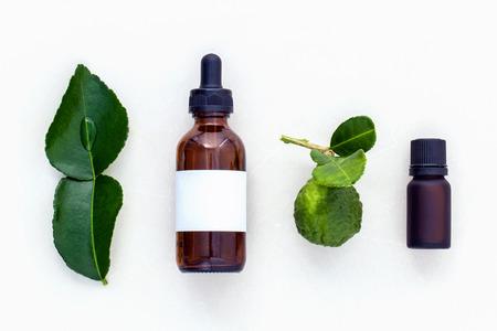 alternative health care: Alternative health care fresh  kaffir llime leaves and oils on marble background.