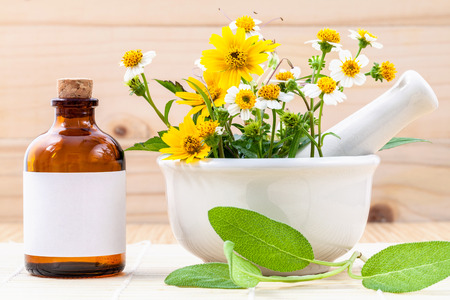 alternative health care: Alternative health care fresh herbal ,oil and wild flower with mortar on wooden background.