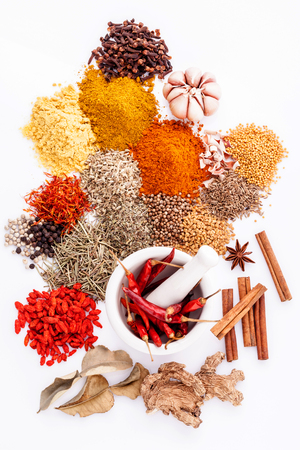 indian spices: Assorted of spices black pepper ,white pepper,fenugreek,cumin ,bay leaf,cinnamon,thyme,matrimony vine(chinese wolfberry),safflower,rosemary and fennel seeds with white mortar isolated on white background.