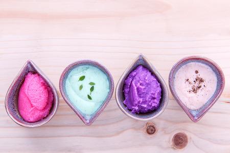Alternative skin care and homemade scrubs  lavender scrubs  ,strawberry scrubs ,avocado scrubs and almond scrubs  on wooden  table. Foto de archivo
