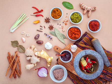 Assortment of Thai food Cooking ingredients and Paste of thai popular food red curry and green curry.