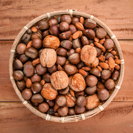 pine kernels: Mixed different kinds of nuts in shells Stock Photo