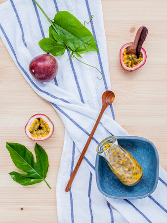 gourmet kitchen: Fresh passion fruits set up on wooden background.