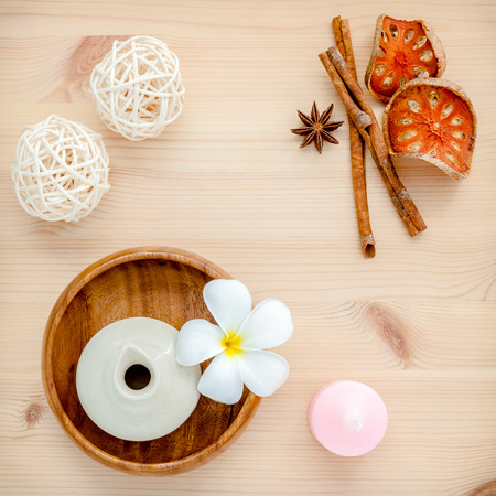 herba: Frangipani tropical flowers with herba spa products . Plumeria flowers with aromatic oil . Thai spa theme aromatherapy  wih herbal. Relaxation with hebal essensial oil.