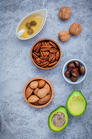 unsaturated: Selection food sources of omega 3 and unsaturated fats. super food high omega 3 and unsaturated fats for healthy food. Almond ,pecan ,hazelnuts,walnuts ,olive oil and avocado. Stock Photo