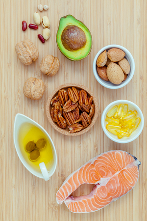 unsaturated: Selection food sources of omega 3 and unsaturated fats. super food high omega 3 and unsaturated fats for healthy food. Almond ,pecan ,hazelnuts,walnuts ,olive oil ,fish oil and avocado . Stock Photo
