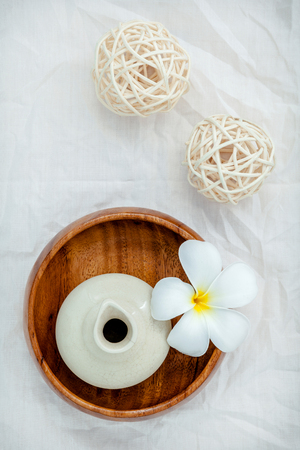 thai spa: Frangipani tropical flowers with herbal spa products . Plumeria flowers with aromatic oil . Thai spa theme aromatherapy  with herbal. Relaxation with herbal essential oil.