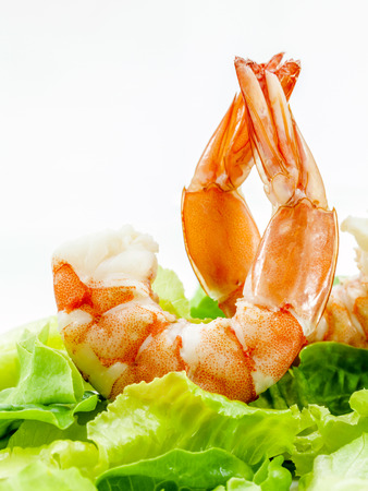 Fresh steamed  prawns with vegetable salad isolate on white background.