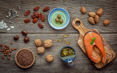 unsaturated: Selection food sources of omega 3 and unsaturated fats. Super food high vitamin e  and dietary fiber for healthy food. Almond ,pecan ,hazelnuts,walnuts ,olive oil ,fish oil ,salmon and flax seed . Stock Photo