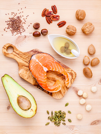 Selection food sources of omega 3 and unsaturated fats. Super food high omega 3 and unsaturated fats for healthy food. Almond ,pecan ,hazelnuts,walnuts ,olive oil ,fish oil ,salmon and avocado . Zdjęcie Seryjne - 65113016
