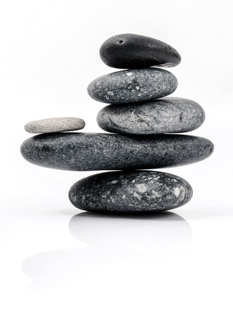 The stack of Stones spa treatment scene zen like concepts. The stack of Stones spa isolated on white background.