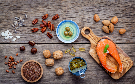 unsaturated: Selection food sources of omega 3 and unsaturated fats. Super food hight vitamin e  and dietary fiber for healthy food. Almond ,pecan ,hazelnuts,walnuts ,olive oil ,fish oil ,salmon and flax seed .