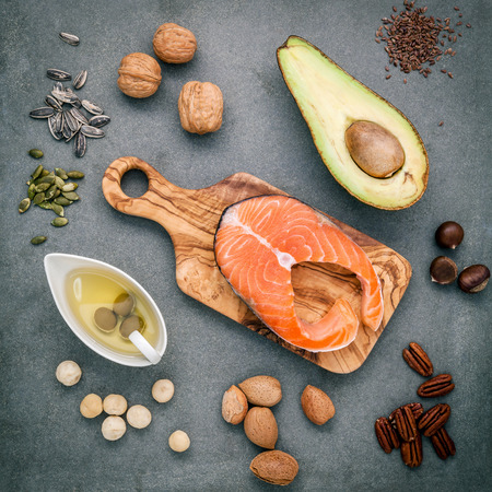 unsaturated: Selection food sources of omega 3 and unsaturated fats. Super food high omega 3 and unsaturated fats for healthy food. Almond ,pecan ,hazelnuts,walnuts ,olive oil ,fish oil ,salmon and avocado .