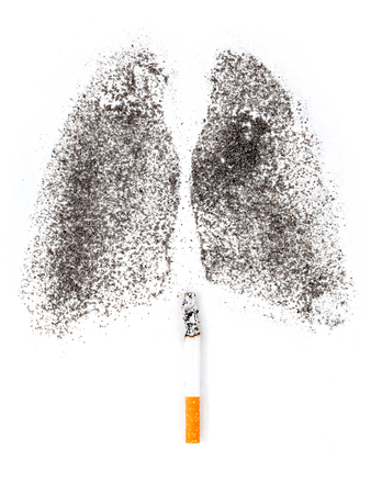 Shape of lungs with charcoal powder and cigarette on white background Stock Photo