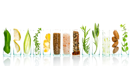 Homemade skin care and body scrubs with natural ingredients aloe vera ,lemon,cucumber ,himalayan salt ,peppermint ,lemon slice,rosemary,almonds,cucumber,ginger and honey pollen isolate on white background.