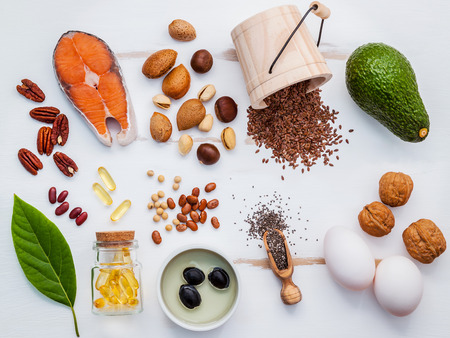 unsaturated: Selection food sources of omega 3 . Super food high omega 3 and unsaturated fats for healthy food. Almond ,pecan ,hazelnuts,walnuts ,olive oils ,fish oils ,salmon ,flax seeds ,chia ,eggs and avocado .