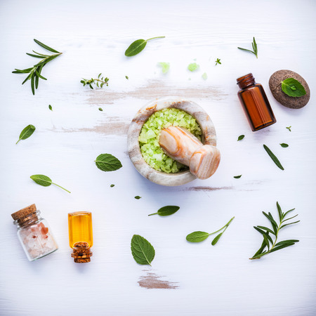 Fresh peppermint ,sage and rosemary. Nature spa ingredients and body scrub. Herbal remedies. Flat lay on white wooden table.